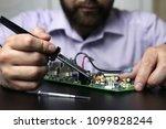 chip soldering man hands   Shutterstock . vector #1099828244