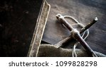 religious old book on a wooden...   Shutterstock . vector #1099828298