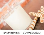 a glass of yogurt with a waffle ... | Shutterstock . vector #1099830530