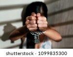 sexual assault and imprisoned... | Shutterstock . vector #1099835300