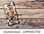 italian bruschetta with cheese... | Shutterstock . vector #1099852700
