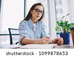 clever hipster girl in eyewear... | Shutterstock . vector #1099878653