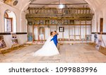 bride and broom pose at... | Shutterstock . vector #1099883996