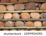 houses with stone walls  ... | Shutterstock . vector #1099904390