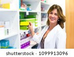 woman customer in the pharmacy | Shutterstock . vector #1099913096