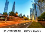 light trails on the street in... | Shutterstock . vector #1099916219