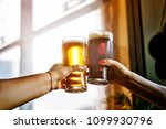 alcohol. two man cheers and... | Shutterstock . vector #1099930796