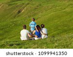 happy family on nature in summer   Shutterstock . vector #1099941350