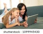 beautiful blonde cute little... | Shutterstock . vector #1099945430