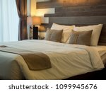Stock photo empty double bed and lamp on side of bed in luxury and natural style bedroom is decorated with 1099945676