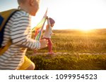 happy childran playing with a... | Shutterstock . vector #1099954523