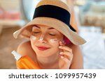 young woman with sun cream on...   Shutterstock . vector #1099957439