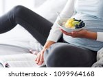 pregnant woman eating and... | Shutterstock . vector #1099964168