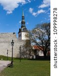 St. Nicholas Church and stone city wall of old Tallinn - stock photo