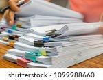 teacher hand holds pen for... | Shutterstock . vector #1099988660