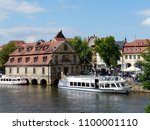 Small photo of Bamberg / Germany - 05.21.2017: Beyond the river is the Institute of Geography of Otto Friedrich University in the former massacre from 1742.