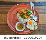 rice topped with stir fried... | Shutterstock . vector #1100019209