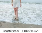 legs of a woman comming out of...   Shutterstock . vector #1100041364