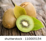 Fresh Kiwis On Wooden Ground