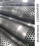 stainless steel perforated tube | Shutterstock . vector #1100054939