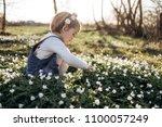 little girl collects flowers   Shutterstock . vector #1100057249