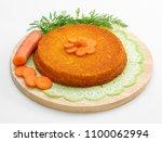 carrot cake on wooden chopping... | Shutterstock . vector #1100062994