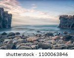 Rocky beach landscape at dusk. Hovs Hallar, Sweden. - stock photo
