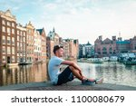 amsterdam netherlands young man ... | Shutterstock . vector #1100080679
