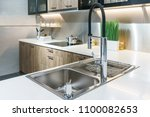 stainless kitchen sink and tap... | Shutterstock . vector #1100082653