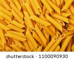 penne pasta as background | Shutterstock . vector #1100090930