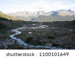 river at laguna esmeralda trek... | Shutterstock . vector #1100101649