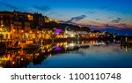 whitby harbour at night with... | Shutterstock . vector #1100110748