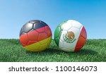 two soccer balls in flags... | Shutterstock . vector #1100146073