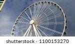 ferris wheel in center at... | Shutterstock . vector #1100153270