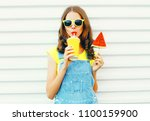 happy cool girl drinks a juice... | Shutterstock . vector #1100159900