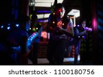 excited guy aiming laser gun at ... | Shutterstock . vector #1100180756