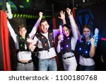 happy young people with laser... | Shutterstock . vector #1100180768