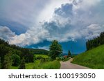 a path leading into a stormy... | Shutterstock . vector #1100193050
