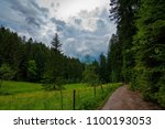 a path leading into a stormy... | Shutterstock . vector #1100193053