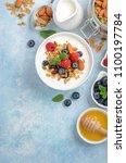 homemade granola with yogurt... | Shutterstock . vector #1100197784