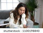 sad girl feeling upset reading... | Shutterstock . vector #1100198840