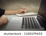 business woman working at... | Shutterstock . vector #1100199653