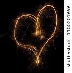 party sparkler heart shape... | Shutterstock . vector #1100204969