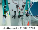 Small photo of Hemodialysis bloodline tubes connect to hemodialysis machine in ICU. Kidney failure,transplantation,medical equipment concept.