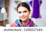 young fashion designer working... | Shutterstock . vector #1100217164