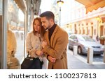 a beautiful young couple... | Shutterstock . vector #1100237813