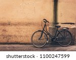 Old Bicycle Against Yellow Wal...