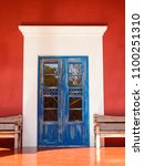 Small photo of Old blue colonial door somewhere in Mexico