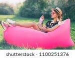 summer lifestyle portrait of... | Shutterstock . vector #1100251376