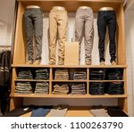 brown pants on the store shelf. ... | Shutterstock . vector #1100263790